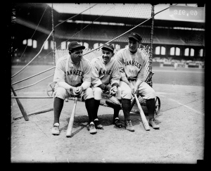 Group portrait of baseball players (left to right) Babe Ruth, Bob Shawkey, and Lou Gehrig of the American League's New York Yankees, sitting on a batting practice backstop on the field at Comiskey Park, Chicago, Illinois, 1930.